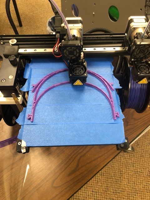 3D printer creating the band for the mask
